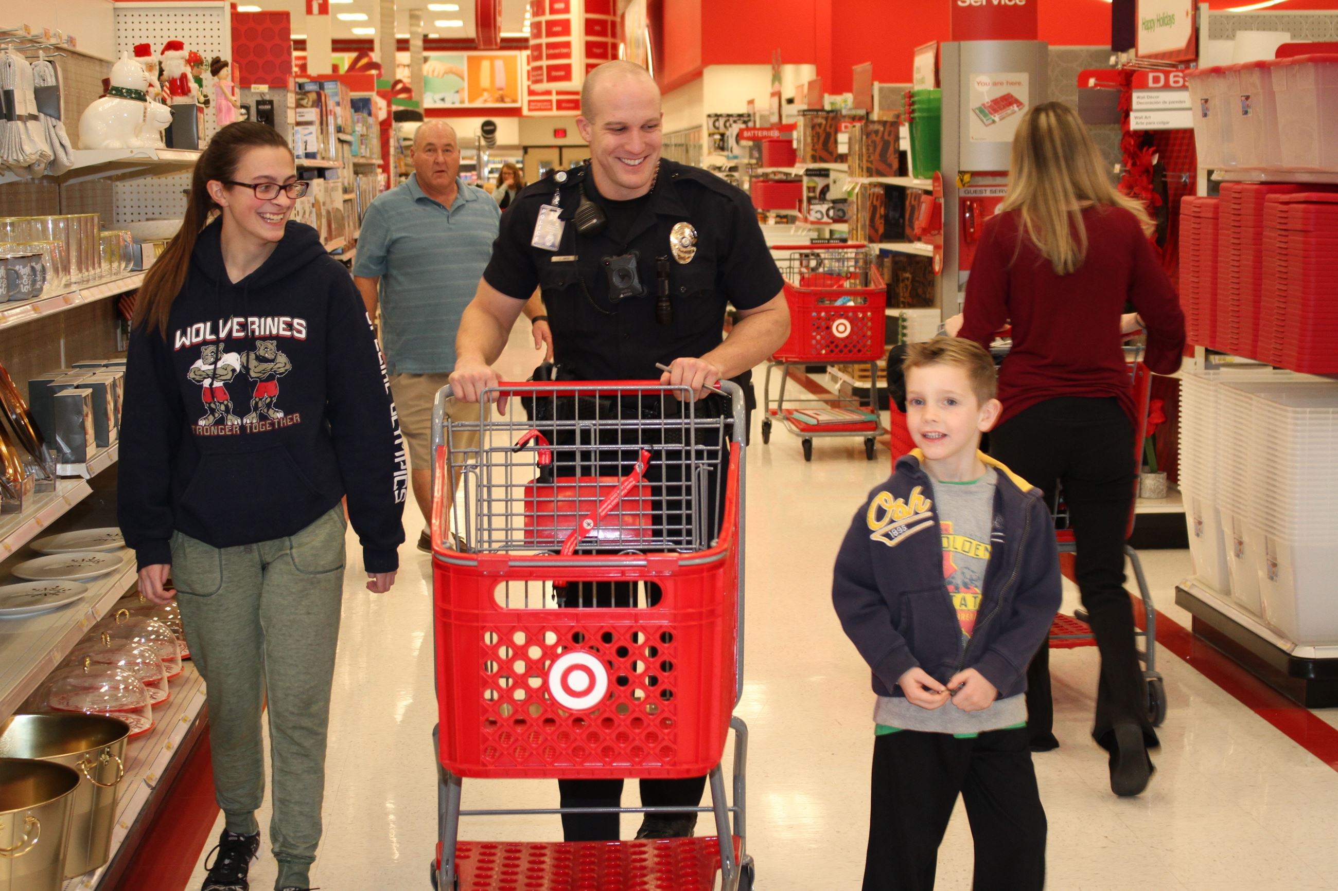 Officer shopping with two laughing children